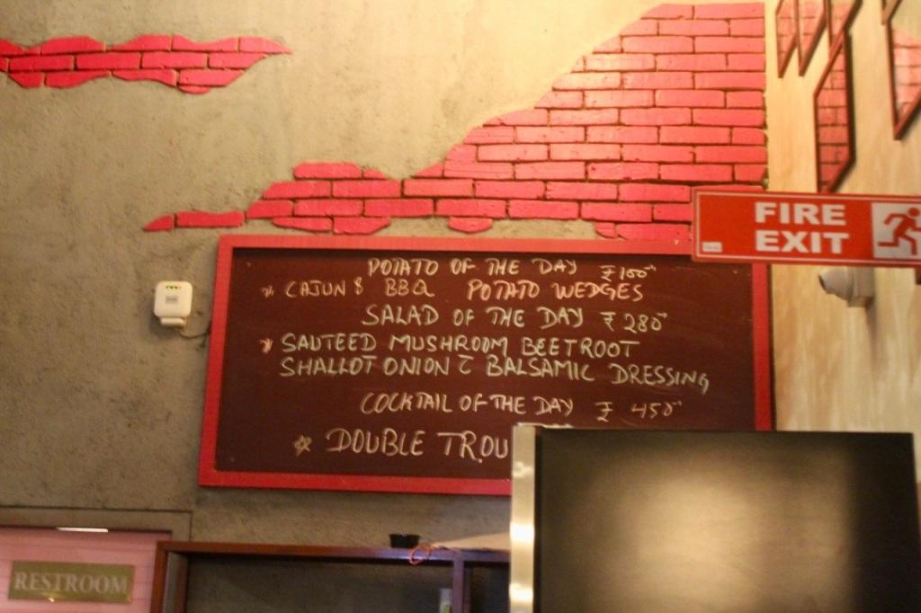 The Sassy Spoon Pune Pink Brick Wall